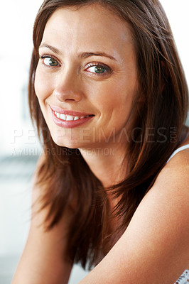 Buy stock photo Closeup portrait of a cute young woman looking at you with a smile