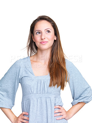Buy stock photo Portrait of a cute young girl thinking while looking at something interesting against white background