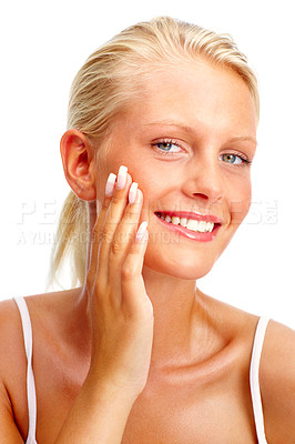 Buy stock photo Closeup portrait of a young woman touching her face , smiling over white background