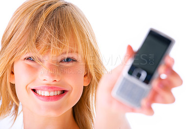 Buy stock photo Young woman holding out mobile phone