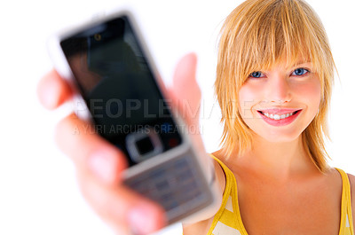 Buy stock photo Young woman holding out mobile phone - Call me!