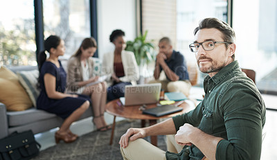 Buy stock photo Portrait of a businessman with his team having a meeting in the background
