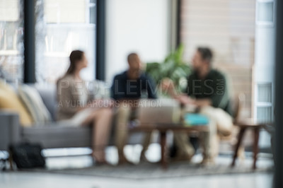 Buy stock photo Blurred shot of a group of colleagues having a meeting at work