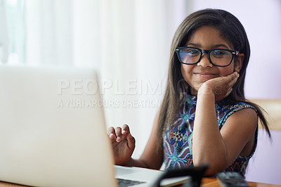Buy stock photo Portrait of a cute little girl using a laptop in her bedroom at home