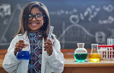 Buy stock photo Portrait of a little girl in a lab coat doing a science experiment in a lab