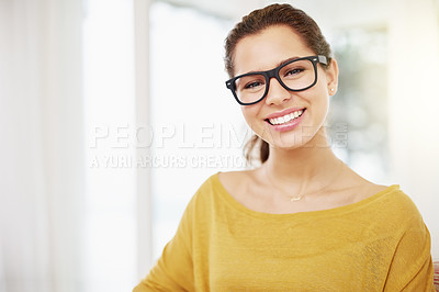 Buy stock photo Cropped portrait of an attractive young woman relaxing at home