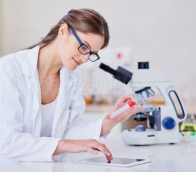 Buy stock photo Shot of a scientist using a digital tablet and microscope while sitting in a laboratory