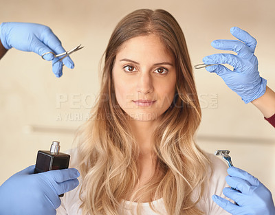 Buy stock photo Portrait of a young woman surrounded by hands holding grooming products
