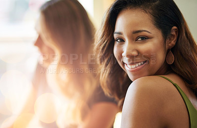 Buy stock photo Cropped shot of a beautiful young woman sitting in a cafe