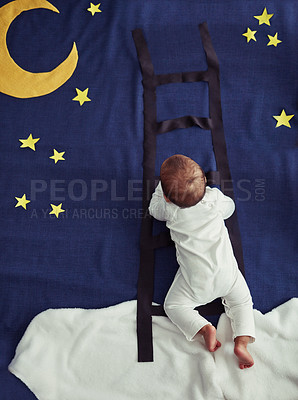 Buy stock photo Concept shot of an adorable baby boy climbing a ladder against an imaginary night time background