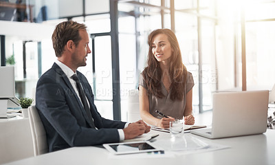 Buy stock photo Cropped shot of two businesspeople having a discussion in an office