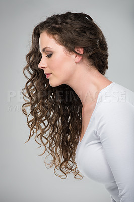 Buy stock photo Studio shot of a beautiful young woman against a gray background