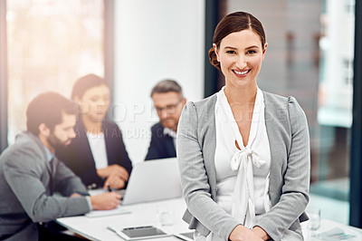 Buy stock photo Portrait of a businesswoman in the office with her colleagues in the background