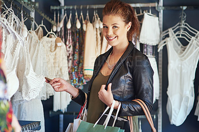 Buy stock photo Cropped shot of an attractive young woman on a shopping spree