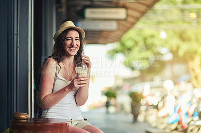 Buy stock photo Portrait of a young woman enjoying a chilled coffee beverage while on vacation
