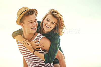 Buy stock photo Cropped shot of an affectionate young couple enjoying their time on the beach