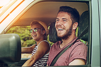 Buy stock photo Cropped shot of two young friends enjoying a roadtrip together