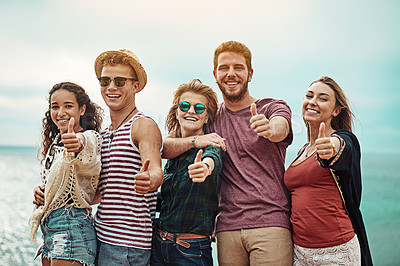 Buy stock photo Portrait of a group of friends showing thumbs up outside
