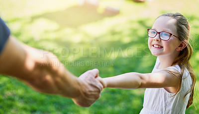 Buy stock photo Cropped shot of a little girl holding her father's hand outside