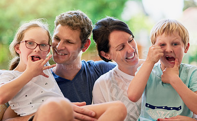 Buy stock photo Portrait of a happy family bonding together outside