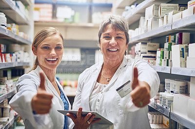 Buy stock photo Shot of pharmacists showing thumbs up in a isle