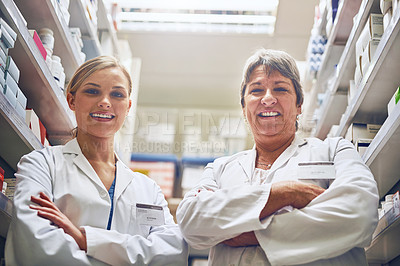 Buy stock photo Portrait of pharmacists standing in a isle with their arms crossed