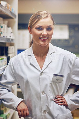 Buy stock photo Shot of an attractive young woman working in a pharmacy