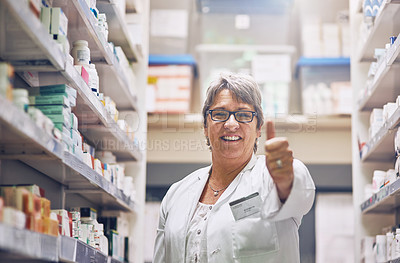 Buy stock photo Shot of a pharmacist showing thumbs up