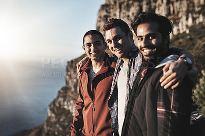 Buy stock photo Portrait of a group of friends admiring the view while hiking in the mountains