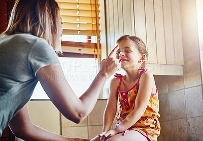 Buy stock photo Cropped shot of a mother and her little daughter having fun while doing housework at home