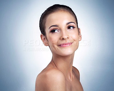 Buy stock photo Studio shot of a beautiful young model posing against a blue background