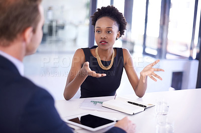 Buy stock photo Cropped shot of businesspeople having a meeting in a boardroom