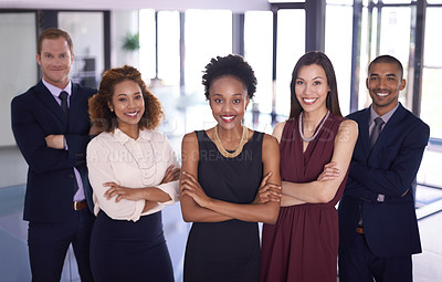 Buy stock photo Portrait of a group of businesspeople standing together