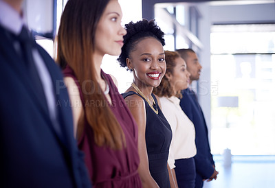 Buy stock photo Shot of a businesswoman standing out from her colleagues