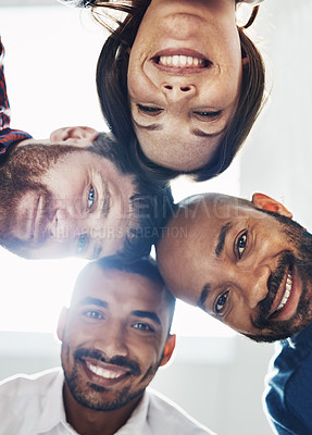 Buy stock photo Portrait of a group of young colleagues huddled together in solidarity