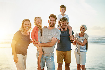 Buy stock photo Portrait of a happy multi-generational family posing on the beach together