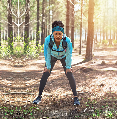 Buy stock photo Full length portrait of an athletic young woman out for a jog in the woods