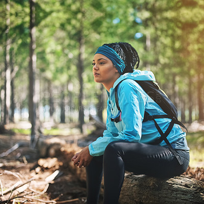 Buy stock photo Cropped shot of an athletic young woman out for a jog in the woods