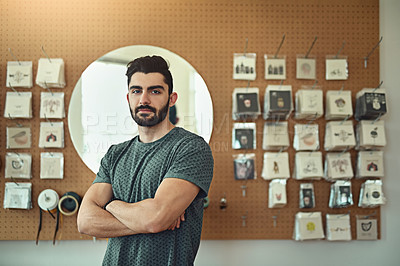 Buy stock photo Portrait of a handsome young designer standing with his arms crossed in the office