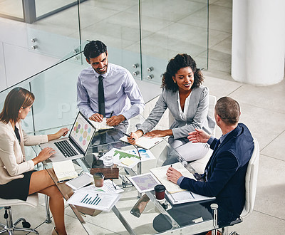 Buy stock photo Shot of a group of businesspeople having a meeting