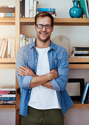 Buy stock photo Cropped portrait of a handsome man standing with his arms crossed at home