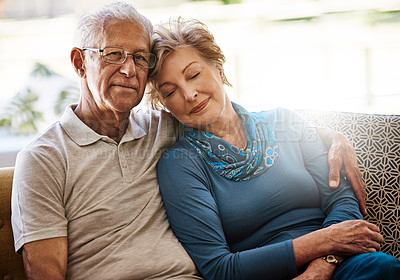 Buy stock photo Portrait of a senior couple relaxing together on the sofa at home