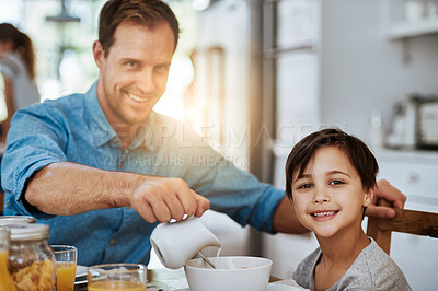 Buy stock photo Portrait of a father and his little son having breakfast together at home