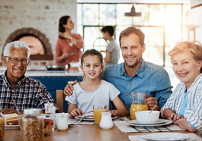 Buy stock photo Portrait of a multi generational family enjoying breakfast together at home