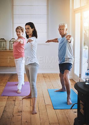 Buy stock photo Shot of a teacher taking two seniors through a yoga class