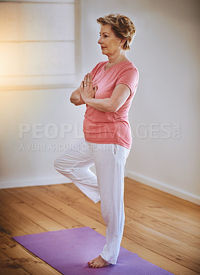 Buy stock photo Shot of a senior woman doing yoga alone