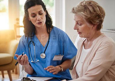 Buy stock photo Shot of a senior woman talking with a nurse in assisted living facility