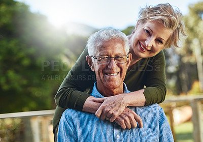 Buy stock photo Portrait of a mature couple posing together in their backyard