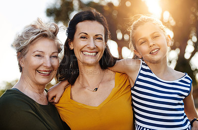 Buy stock photo Portrait of a cute little girl posing outside with her mother and grandmother
