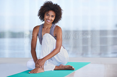 Buy stock photo Shot of an attractive young woman sitting on an exercise mat
